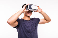 Portrait of young excited man experiencing virtual reality. Isolated on white background Stock Photography