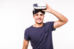Portrait of young excited man experiencing virtual reality. Isolated on white background Stock Photos