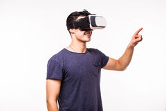 Portrait of young excited man experiencing virtual reality. Isolated on white background Royalty Free Stock Photo