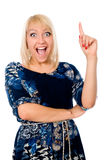 Portrait of young excited woman pointing up and smiling. Stock Photo