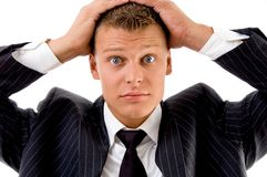 Portrait of young executive holding his head Royalty Free Stock Image