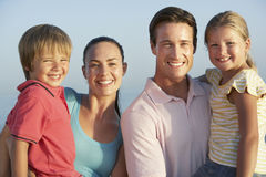 Portrait Of Young Family On Beach Holiday Stock Images