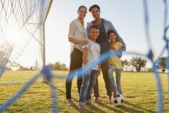 Portrait of a young family during a football game royalty free stock photo