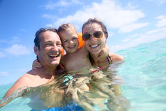 Portrait of a young family having fun in the sea Royalty Free Stock Photo