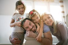 Portrait of young family at home. royalty free stock images