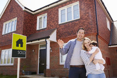 Portrait Of Young Family With Keys To New Home stock images