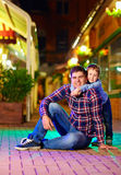 Portrait of young family on night city street Stock Photo