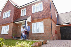 Portrait Of Young Family Standing Outside New Home Royalty Free Stock Photo