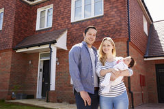 Portrait Of Young Family Standing Outside New Home Stock Photo