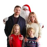 Family portrait with Santa Claus stock images