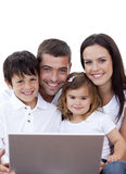Portrait of young family using a laptop Stock Photo