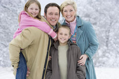 Portrait of young family in winter setting Stock Image