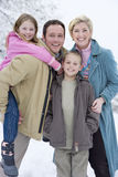 Portrait of young family in winter setting stock images