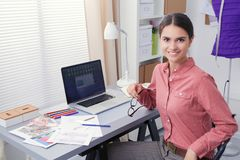 Portrait of a young fashion designer working on her atelier.  Royalty Free Stock Photography