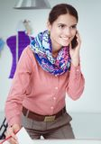 Portrait of a young fashion designer working on her atelier.  Royalty Free Stock Images