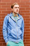 Portrait of young fashion man in casual wear and wooden bowtie Royalty Free Stock Photos