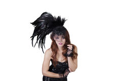 Portrait of young fashion model wearing feathered headdress over white background Stock Photography