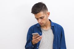 Portrait young fashion talking mobile phone. Young fashioned mobile phone on the wall Royalty Free Stock Photo