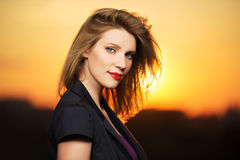 Portrait of young fashion woman at sunset Royalty Free Stock Photos