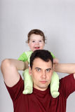 Portrait of young father holding a smiling little son Stock Photo