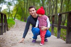 Portrait of Young father walking with his cute Stock Photos