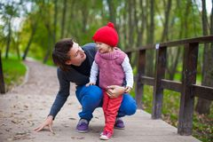 Portrait of Young father walking with his cute Stock Photography
