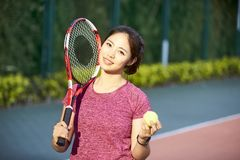 Portrait of young female asian tennis player royalty free stock photography