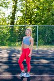 Young Female Athlete Working Out on Track Royalty Free Stock Photos