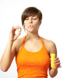 Portrait of a young female blowing soap bubbles Stock Photography