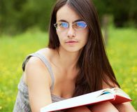 Portrait of a young  female with a book Royalty Free Stock Images