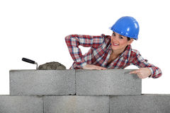 Portrait of young female bricklayer Royalty Free Stock Photography