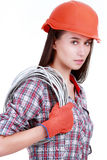 Portrait of young female builder in helmet with cabel on white Stock Images
