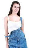 Portrait of young female builder in overalls on white. Portrait of young female builder in helmet painting on white Royalty Free Stock Photography