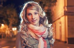 Portrait of a young female businesswoman in night Stock Photo
