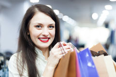 Portrait of young female buyer. With shopping bags Royalty Free Stock Image