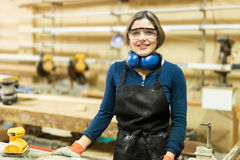 Portrait of a young female carpenter Stock Image