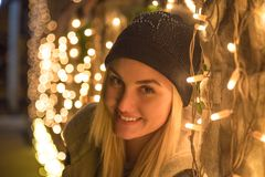 Portrait of young female with Christmas decoration lights royalty free stock photos