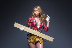 Portrait of young female construction carpenter Royalty Free Stock Photo