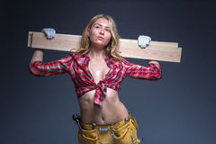 Portrait of young female construction carpenter Royalty Free Stock Photos