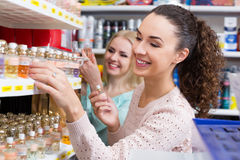 Portrait of young female customers shopping. In beauty store Royalty Free Stock Image