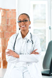 Portrait of young female doctor in clinic Stock Images