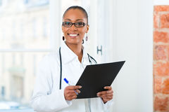 Portrait of young female doctor in clinic Stock Image