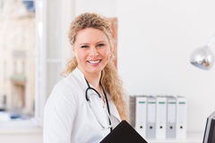 Portrait of young female doctor in clinic with file Stock Photography