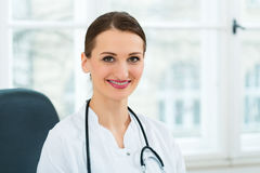 Portrait of young female doctor in clinic Royalty Free Stock Photography