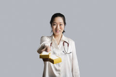 Portrait of a young female doctor giving medicine boxes Stock Photography