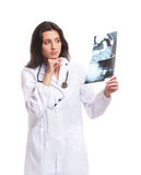 Portrait of a young female doctor in a white dress Stock Photography
