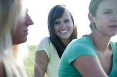 Portrait of a young female with friends Royalty Free Stock Image