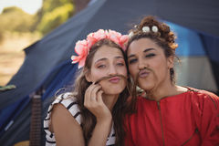 Portrait of young female friends against tent Stock Image