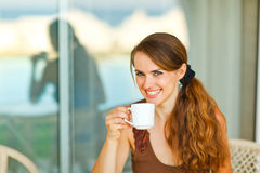 Portrait of young female having cup of coffee Royalty Free Stock Photos