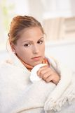 Portrait of young female having flu feeling bad Stock Photo